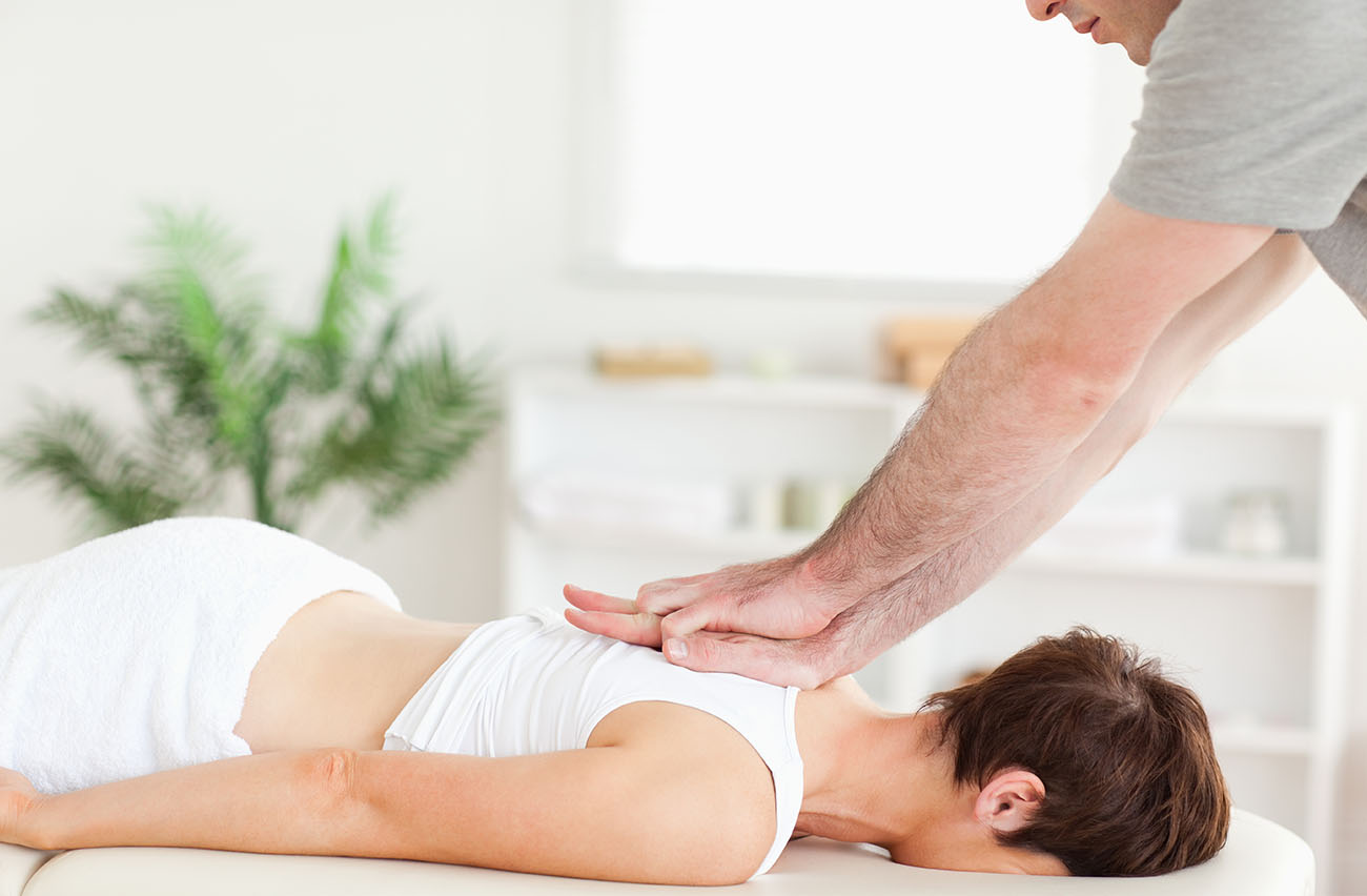 woman getting chiropractic massage treatment